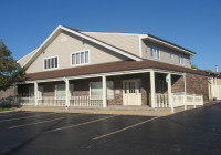 Sold Commercial Building with 2 Leased Apartments in Huntley